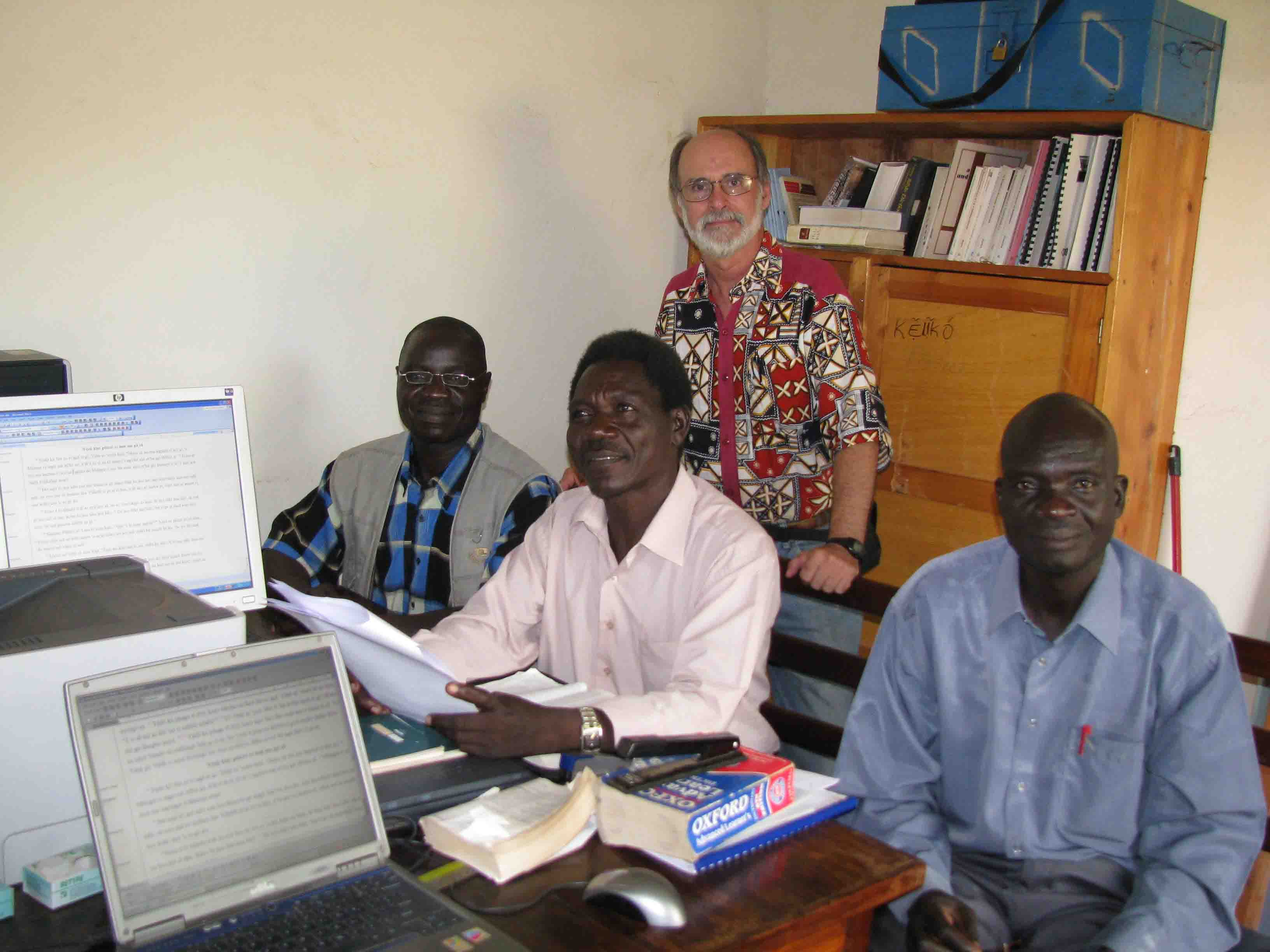 Consultant Wes Ringer helps check the Book of John with the translation team