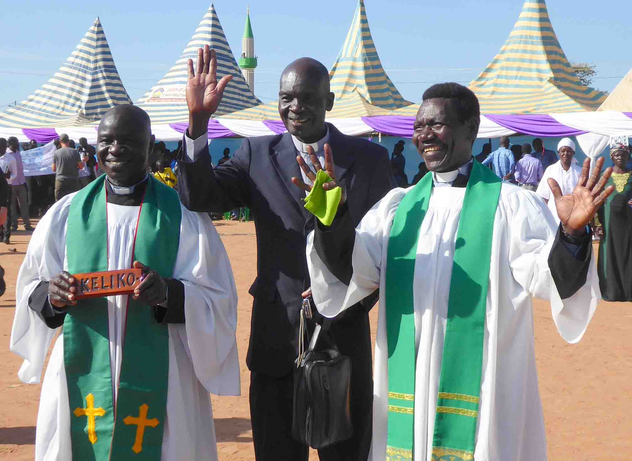 Translators and pastors Ezekiah Dada, Isaac Kenyi and Enos Dada celebrate the completed Keliko New Testament. Photo: April Haberger.