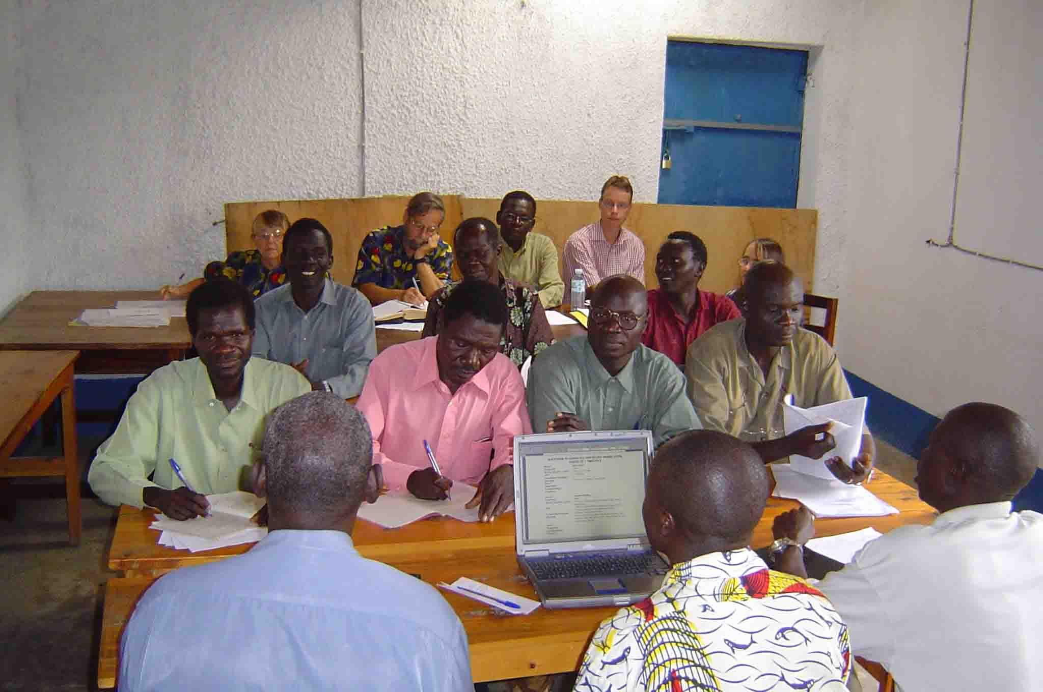 May, 2006: Consultants Joy and John Anderson (back row, left) work with the team to check 1-2 Timothy.