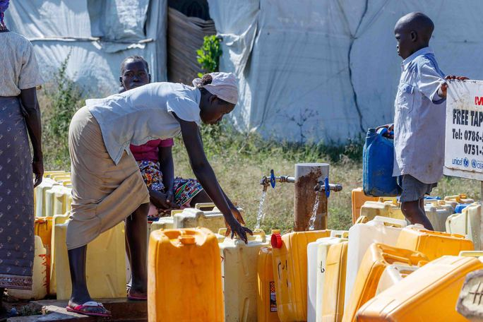 Woman filling water cans