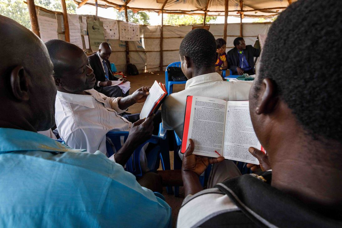 In an advanced literacy class, literacy specialist Elisa                                 Anyani (back left) has students read the Keliko New Testament which sparks                                 meaningful discussions.