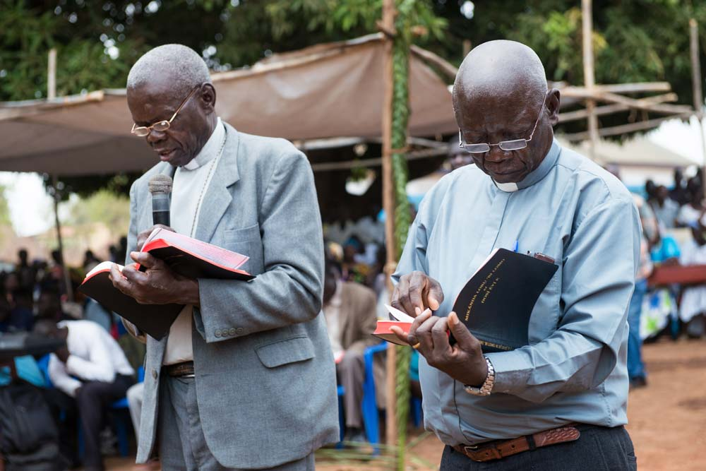 Pastors read from the new Baka Bibles