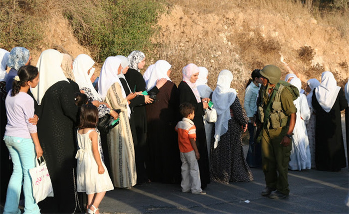 women lined up at checkpoint