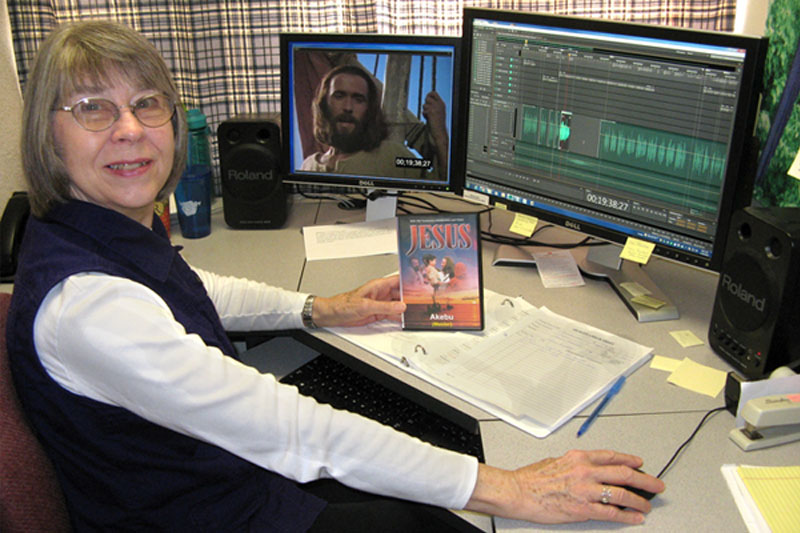 Woman working on the JESUS film voice synchronization