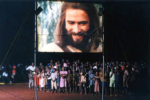 People from nearby villages gather to watch the JESUS film.