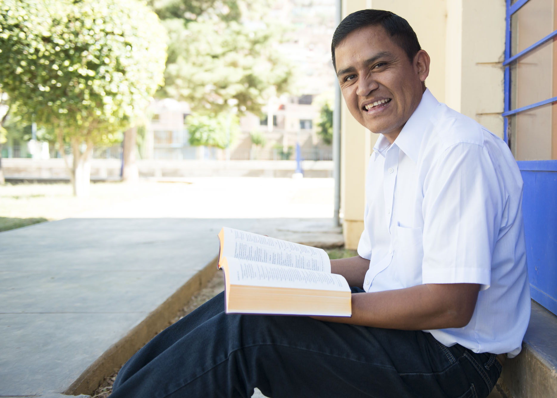 A translator reads the New Testament in Quechua.