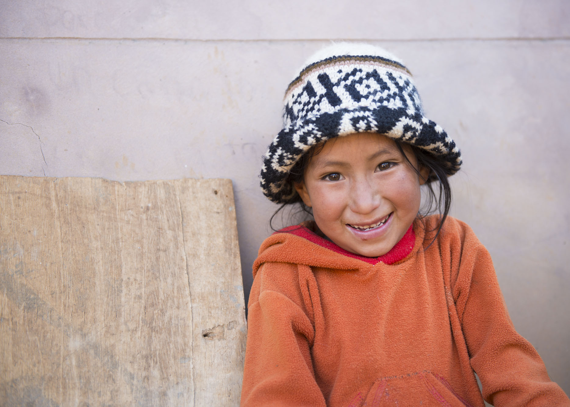Quechua girl smiles at the camera