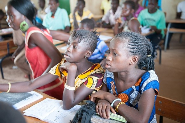 Young girls learning to read and write