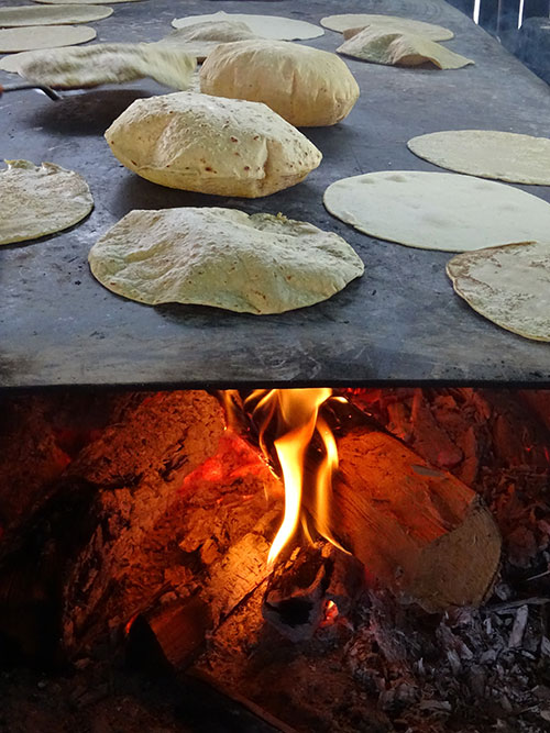 tortillas cooking on griddle for the celebration
