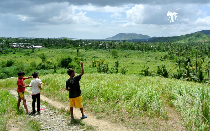 Filipino boys flying a kite