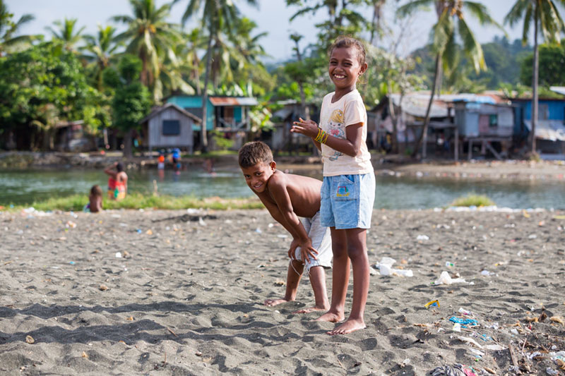 Boys playing on Solomon Islands beach