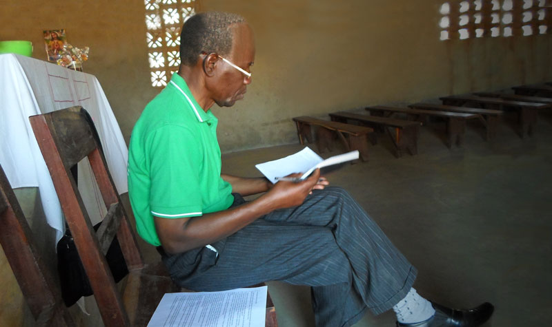 Nyungwe man reading the Scriptures