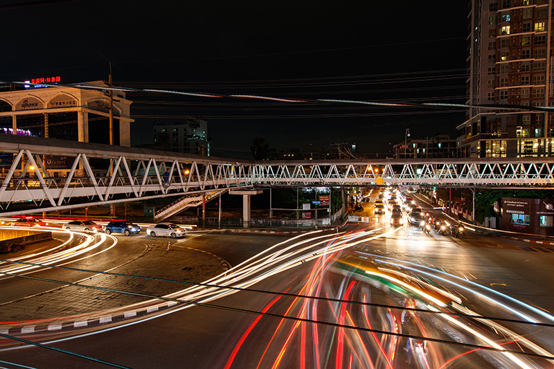 Cars lights streaking at night - time delay image