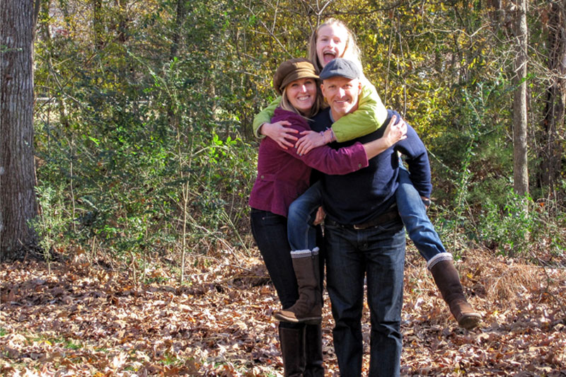 Missionary family having fun on a hike in the woods