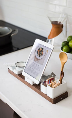 An ipad in a stand on kitchen countertop, displaying a recipe