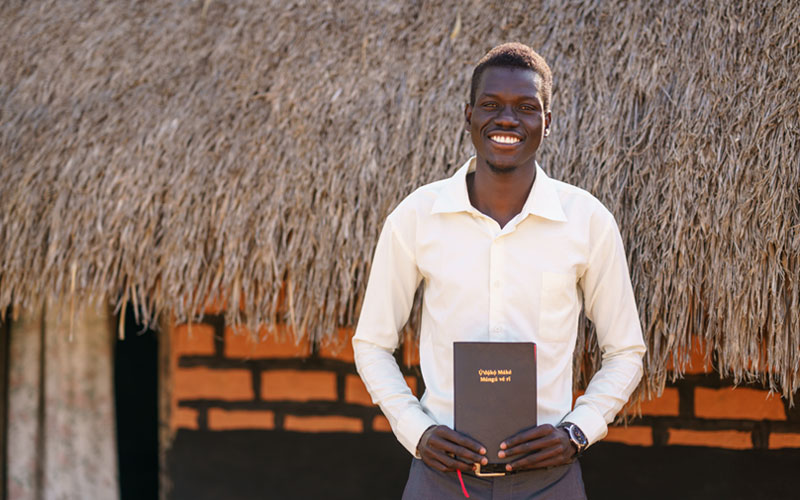 happy man holding his new Bible