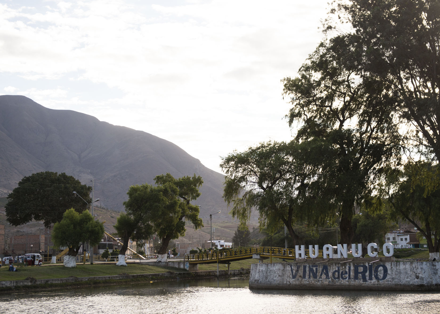 The Huanuco city sign over a river