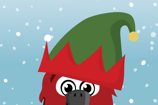 Mack wearing a Christmas hat with snow falling around him