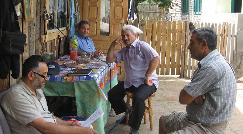 Roma men translating